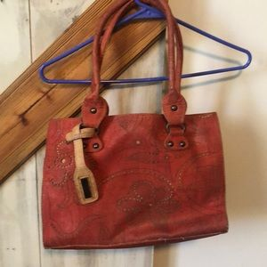 Red artelusa cork bag with dust cover.